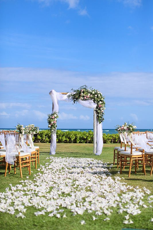 Hawaiian beach front wedding arch decor